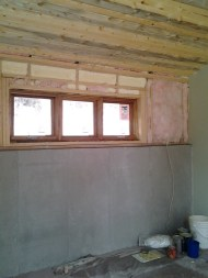 Master Bedroom with beetle kill paneling and exposed concrete