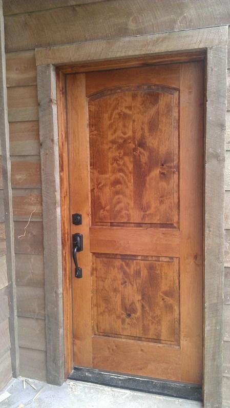 Entry Door in Alder. BKP siding will darken to a rich grey in several months.