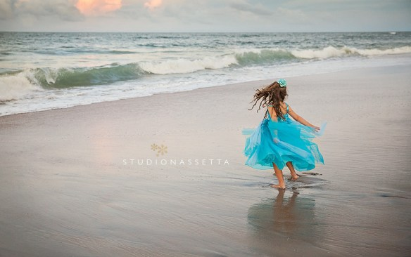 girl spinning on beach in Nags Head NC