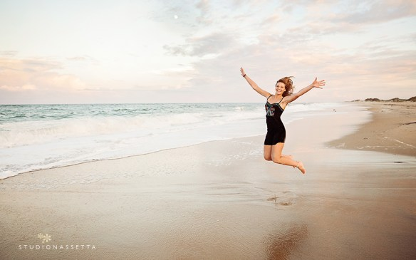 high_school_girl_jumping_on-the-beach_nags-head_nc