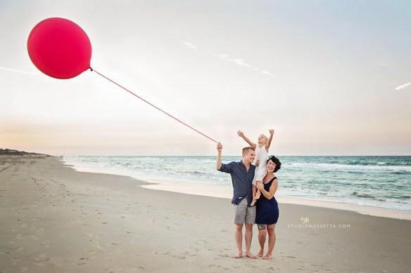 family beach photography with red balloon in OBX NC