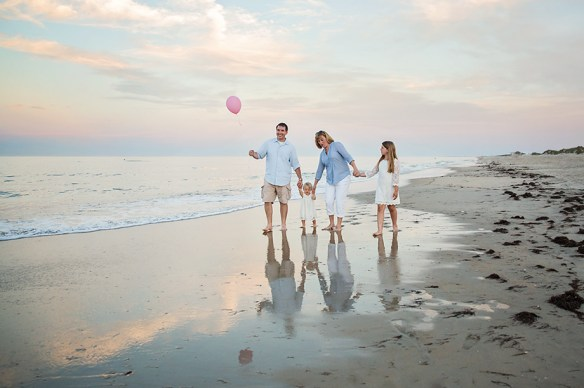 family walking photograph with Balloon in Nags head NC beach