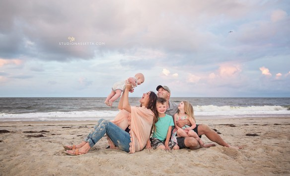 family of five photograph with gorgeous sunset on the beach in Nags Head in Outer Banks NC