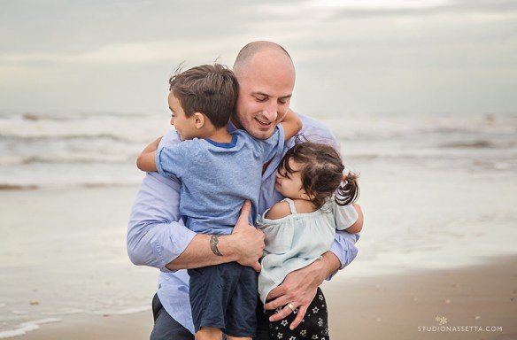 Outer Banks family photography, father hugs kids by the ocean, beaches of OBX NC
