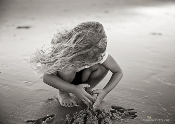 girl playing with sand in Corolla NC_black white photograph
