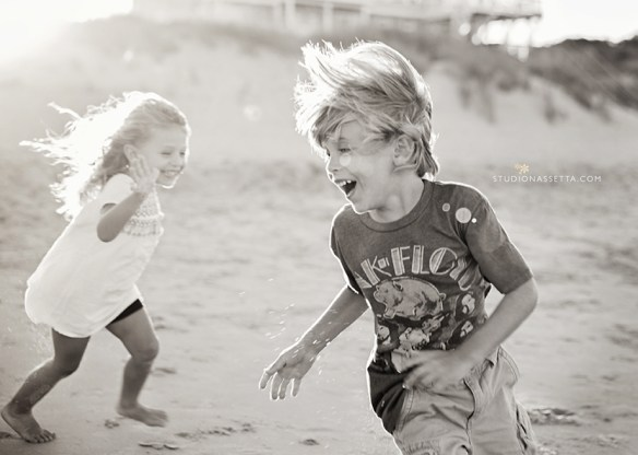 lifestyle photography - joy and chaos children chasing in OBX Pine Island NC