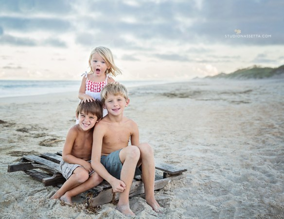 sibling kids portrait on old pallet on the beaches of nags head NC