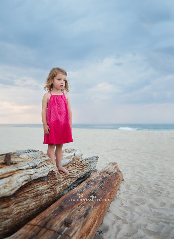 Girl standing on a shipwreck in the beach of Corolla NC