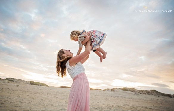 Sunset photo of Mother lifting daughter in Nags Head NC