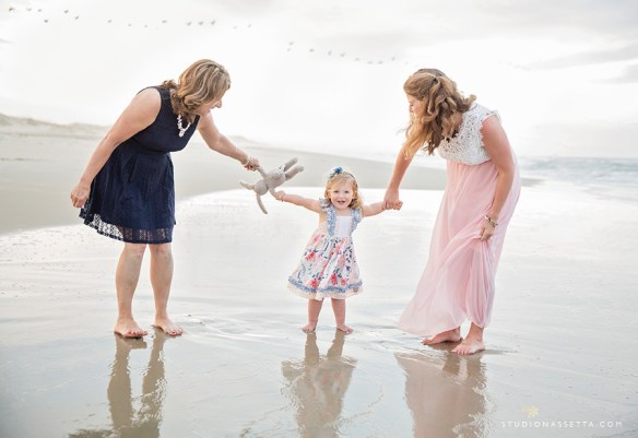 Mommy, Grandma, and little girl walking by the water in Outer Banks NC