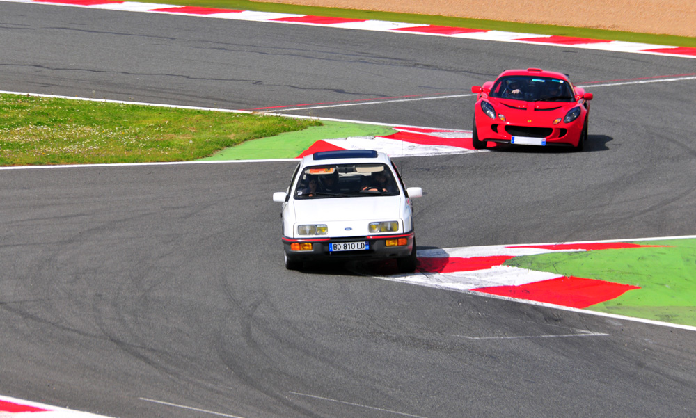 Ford Sierra Cosworth and Lotus Elise during Classic Car Day at Magny Cours circuit, 05/05/2013.