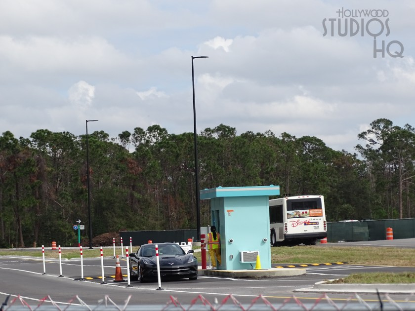 Looking first at the arrival traffic work, vehicles now have a new entrance pattern when entering off Lake Buena Vista Drive. This is a temporary traffic entrance lane that will eventually transform into an exit only after Stars Wars Galaxy Edge opens next year. Disney is also switching all of the street lights in the parking lots to a new LED energy efficient lighting for greater safety and visibility. However, this bright idea results in one section out of the four main sections of the parking lot closed at a time for the near future. Fans plan accordingly and perhaps arrive early for a parking spot. Looking skyward, columns are appearing for the gondola skyway system constructed near the entrance of the park. Most noticeable is this construction activity at the end of the parking lot where the skyway system will connect guests to Caribbean Beach Resort.