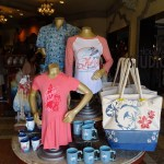 While the calendar indicates mid-February, the unusual warm Orlando temperatures this week and the new selection of family beach gear at Carthay Circle on Sunset Blvd, indicate waves ahead for great summer fashions! Select from a wide assortment of stylish men's button down shirts, colorful surf t-shirts as well as hats, all designed to have you lounging by the water in Disney style. Enticing summer clothing for women and children is also now on store shelves. Likewise all the accessories a guest will need for ocean front or pool side relaxation are offered as well. Take a look now at these photos and descriptive video.