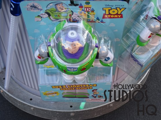 In advance of this summer's opening of the Toy Story Land attraction, young and old can now enjoy a Buzz Lightyear bubble blower toy complete with LED light up effects. Guests are surrounded in the park by this new toy now available at all outside merchandise carts including the front gate Movieland Memorabilia merchandise location. Get bubbling immediately as the solution and AAA batteries are included at Disney's Hollywood Studios. Photo by John Capos