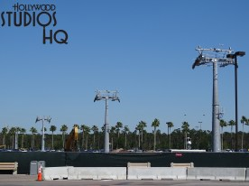 Visitors traveling from guest parking to the main Park entrance will now notice the completion of five Skyliner Transportation System towers visible in the parking areas. Construction focus will likely turn to installation of gondola cabling for the route to the Caribbean Beach Resort as well as completion of the Hollywood Studios arrival and departure station near the main entrance. In case any old timers are wondering, the original ticket booth that greeted guests for many years is completely gone from the Lake Buena Vista Drive entrance location and awaiting final removal as visible in the photo below. The latest signs of future parking lot construction progress are found across from the cast member parking lot. Here crews have been busy paving new roadway. Disney's Hollywood Studios. Photo by John Capos