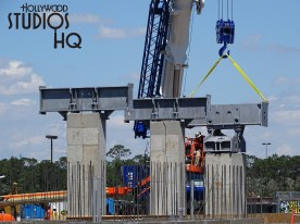 An exciting photographic look this week at the Hollywood Studios Skyliner station is below for readers. Wood framing has now given way to concrete structures as crews erect additional horizontal steel beams on top of the metal columns to support this transportation system. Large shrub foliage has been planted near the original water pathway that was recently closed to guests. Also note a wooden walk way used by construction crews is being positioned in the direction where the first gondola on opening day will travel with its riders inroute to the Disney Caribbean Beach Resort. Disney's Hollywood Studios. Photo by John Capos