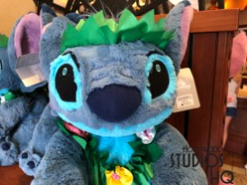 Fans of experiment 626 will want to visit mischievous Stitch's new array of merchandise inside Carthay Circle. Guests can select from adult and child apparel, backpacks, character gloves, notebooks, women's purses and wallets, and accessories. A new irresistible Stitch plush adorned with an Hawaiian lei is on store shelves. Why not chose a new coffee mug for home. Two designs of Stitch hats can be purchased. A lovable Angel plush, Stitches' friend, is also available complete with a Hawaiian flower adorning her ear. Lilo joins the image of Stitch on clear water bottles for purchase just in time for warm days in the Park. Photos below detail this merchandise selection. Disney's Hollywood Studios. Photo by John Capos
