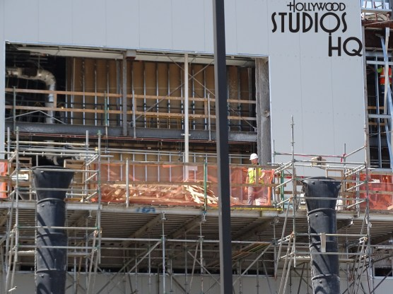Construction crews have turned the final corner to now enclose the remaining side of one of Planet Batuu's main structures as captured in photos below. Likewise, scaffolding encompasses numerous towers and spires to allow workers to continue the finishing work on these high rise structures. Contractors continue to utilize charter bus shuttles to efficiently ferry crews to and from the compact construction vehicle entrances. View the latest photos below for a firsthand view of numerous construction efforts underway at Star Wars: Galaxy's Edge. Disney's Hollywood Studios. Photo by John Capos.