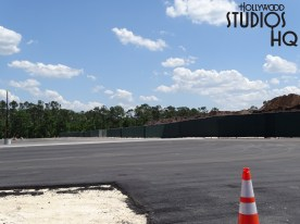 New parking space striping as well as night lighting is rapidly appearing in the expanded Hollywood Studios guest parking adjacent to cast parking, normally the Minnie Mouse Television areas. Crews are also working to complete the new Park entrance roadway, as pictured below. Workers were spotted checking asphalt surface levels and completing perimeter guard railing. Disney's Hollywood Studios. Photo by John Capos.