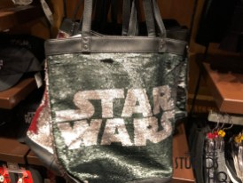 Star Wars shoppers will clamor to this store for the new colorful merchandise selection including adult and child themed hats and tee shirts. Galactic sling bags, purses, along with pajama pants await Star Wars attraction riders as they descend the exit ramp directly into the shop. Black and red flip flops as well as jackets are available in child sizes and are great to outfit those young fans attending the upcoming May 27 Star Wars: Galactic Nights event. Disney's Hollywood Studios. Photo by John Capos