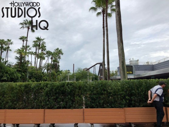 Upon recent completion of a replacement sidewalk project in front of the Hyperion Theater, workers have once again re-routed guest foot traffic for another sidewalk closure directly past the Theater exit doors. Guests now use a narrow walk way past the Path of the Jedi film and the Olaf Meet and Greet to bypass this new concrete work. As pictured below behind the portable foliage barriers, this renovation is just beginning. Disney's Hollywood Studios. Photo by John Capos