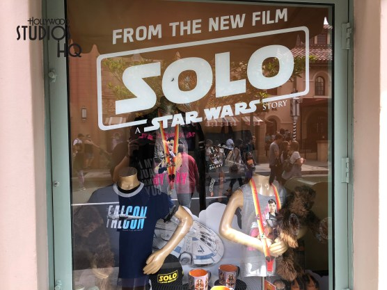 Sidewalk window displays feature the new Solo: Star Wars motion picture main characters. Attention getting images of Han Solo, Qi'ra, Chewie, and Lando, along with authentic film-themed merchandise, fill three main Mickey's of Hollywood's sidewalk display windows. Guests cannot help miss these attention catching images on Hollywood Blvd., conveniently captured below in photos. Disney's Hollywood Studios. Photo by John Capos