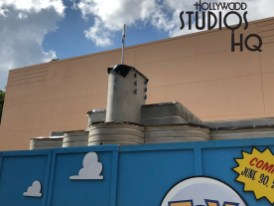 A new single building located at the main entrance to Toy Story Land is nearing completion. Previously obscured by construction wrap, this structure is now partially visible above construction walls to passing guests. With the metal roofing almost completed, the specific function of this entrance structure is yet to be identified. Fans of all ages are eagerly awaiting the grand opening of the Toy Story Land attraction later this month. Disney's Hollywood Studios. Photo by John Capos
