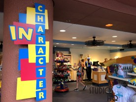 New shop signage and giant tinker toy themed merchandise shelving awaits shoppers at the In Character store. The newly painted ceiling includes shades of the Pixar blue. The shop continues to offer an assortment of Disney Princess themed merchandise and some child apparel. Disney's Hollywood Studios. Photo by John Capos