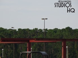 Crews have now closed the entire Stage guest parking area and have quickly erected multiple steel beams for a new structure taking shape. New decorative outdoor lighting as well as tall palm tree foliage is now visible in the lot. Surface paving is underway and precast concrete pipes are awaiting installation. Check Hollywood Studios HQ weekly for updates on this emerging construction project. Disney's Hollywood Studios. Photo by John Capos