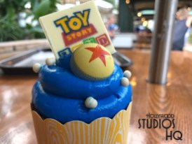 Guests will want to celebrate the new Toy Story Land with a delicious new themed cupcake. This tasty chocolate cupcake pictured below comes with a Toy Story blue vanilla buttercream topping and even a small chocolate replica Toy Story Land insert. Complete with a Pixar ball logo nestled in the topping, this dessert awaits diners at both the ABC Commissary and the Sunset Ranch Market dining locations. Disney's Hollywood Studios. Photo by John Capos
