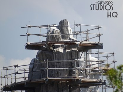 Star Wars fans eager for the Planet Batuu's opening can view the latest construction efforts in the photos below. Roof covering of the main temple roof surface has been completed. An American flag now positioned atop a high metal structure signifies the crews topping out of that work. Construction efforts include placement of grass and snow surfaces of various mountain ranges. Star Wars: Galaxy's Edge. Disney's Hollywood Studios. Photo by John Capos