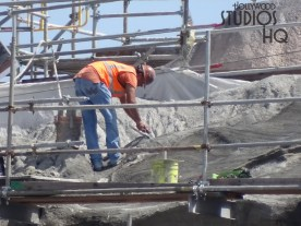 Construction crews are working to finish the exterior of the Planet Batuu mountainous terrain as a crane delivers material high above. Scaffolding can still be seen surrounding some of the highest mountain peaks nearing completion while workers have installed a white roofing base material on a circular roof. Hollywood Studios HQ continues to provide the latest construction updates so stay tuned. Star Wars: Galaxy's Edge. Disney's Hollywood Studios. Photo by John Capos