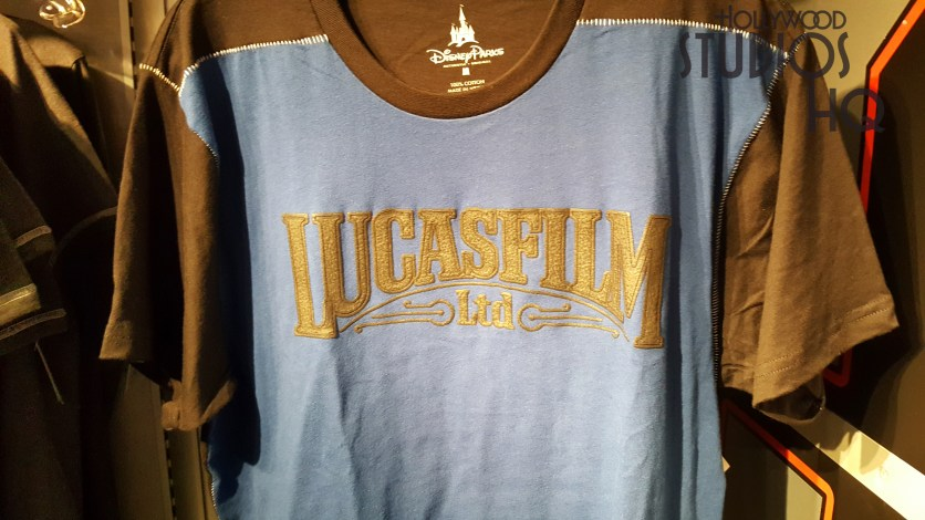 New Lucasfilm adult apparel and other themed accessories await shoppers on Launch Bay Cargo shelves. Colored tee shirts with the bold Lucasfilm logo along with a coordinated cap are available inside the stores main entrance. Guests can add a themed Executive black ballpoint ink pen or refrigerator magnet to their purchase. Disney's Hollywood Studios. Photo by John Capos