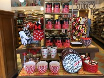 Shoppers can select from an array of household accessories that feature the beloved Minnie Mouse. This character has added her colorful red, white, and black polkadots to this new main merchandise display. Featured on store shelves are teapots, plates, as well as new water bottles. Disney's Hollywood Studios. Photo by John Capos