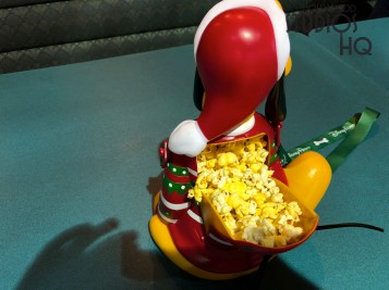 Guests can enjoy their popcorn snack in a new Pluto character bucket. Complete with a colored holiday sweater and Santa hat, Pluto holds a generous serving of hot and fresh popcorn. This purchase is available throughout the Park at outdoor refreshment locations for $15. Disney's Hollywood Studios. Photo by John Capos