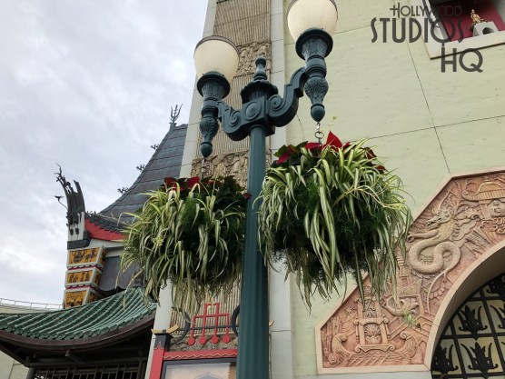 Holiday foliage continues to be added to the Park's festive atmosphere. Christmas decorations have been added to the ABC Commissary que area while hanging plants adorning center stage lamp posts have holiday accents. Disney's Hollywood Studios. Photo by John Capos