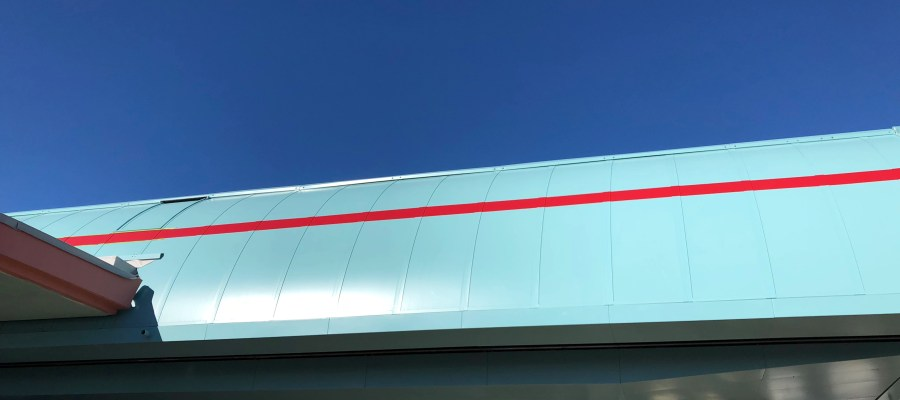 Painting crews have added a red colored accent stripe to the Skyliner exterior metal shell. Electrical work also continues with the installation of surveillance cameras above walk ramps. The latest Skyliner news is always here at Hollywood Studios HQ. Disney's Hollywood Studios. Photo by John Capos
