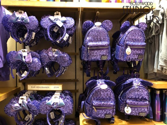 Purple is the focus of new merchandise on shelves inside Mickey's of Hollywood. Purple lovers can shop for Mickey Mouse ear headbands, backpacks, women's tops, and even colorful water bottles all in the purple color. Stay tuned to Hollywood Studios HQ for the latest in merchandise trends. Disney's Hollywood Studios. Photo by John Capos