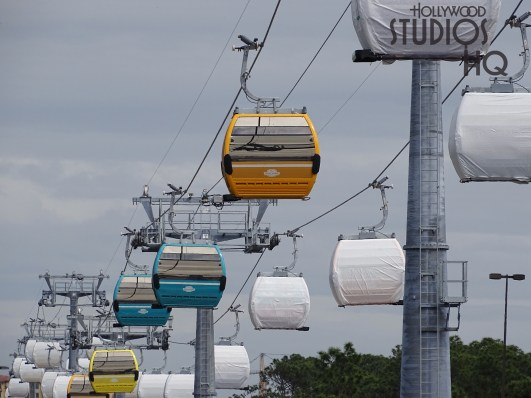 Crews continue day and night construction efforts to finish the Park's Skyliner station. Metal safety railing installation and concrete walkway ramp work is visible. Roof top columns have been added and await painting. Yellow , blue and orange colored gondolas are now visible. Hollywood Studios HQ has the up to date details on Skyliner construction. Disney's Hollywood Studios. Photo by John Capos