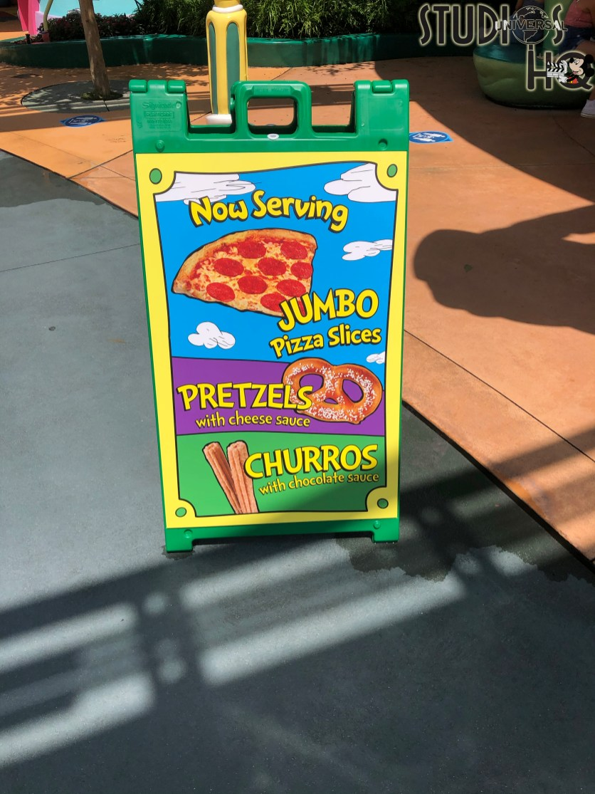 Guests can enjoy refreshments while exploring Seuss Landing at the popular Moose Juice Goose Juice location. Selections include jumbo pizza slices, delicious pretzels with cheese sauce, along with churros with chocolate sauce. A variety of Minute Maid juices and fountion drinks round out a great meal for visitors. Find up to date dining information right here on Hollywood Studios HQ. Photo by John Capos