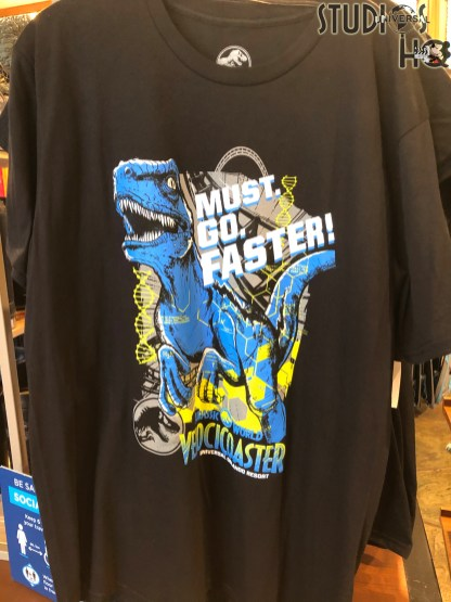 Guests can now purchase new VelociCoaster themed merchandise at retail locations throughout Islands of Adventure, Universal Studios, and City Walk. A selection of adult tee shirts, socks, key chains, magnets, mugs, shot glasses, and lanyards themed to the new VelociCoaster await shoppers. The exciting VelociCoaster is anticipated to debut this summer 2021. Stay connected to Hollywood Studios HQ for all Universal Orlando news! Photo by John Capos