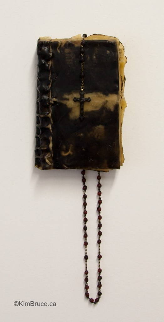 "Book Of... Encaustic and rosary on a book, 15""h x 5""w x 1.75""d overall"