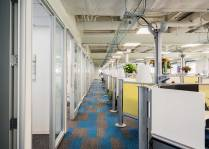 Salary.com's hallway features a bold rug design (Boston real estate design and architecture)