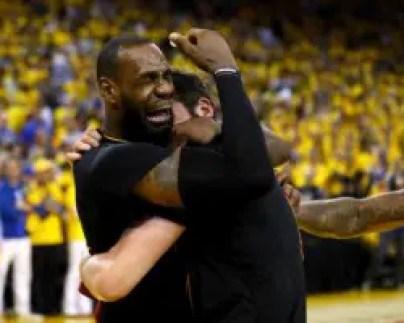 Lebron embracing Kevin Love