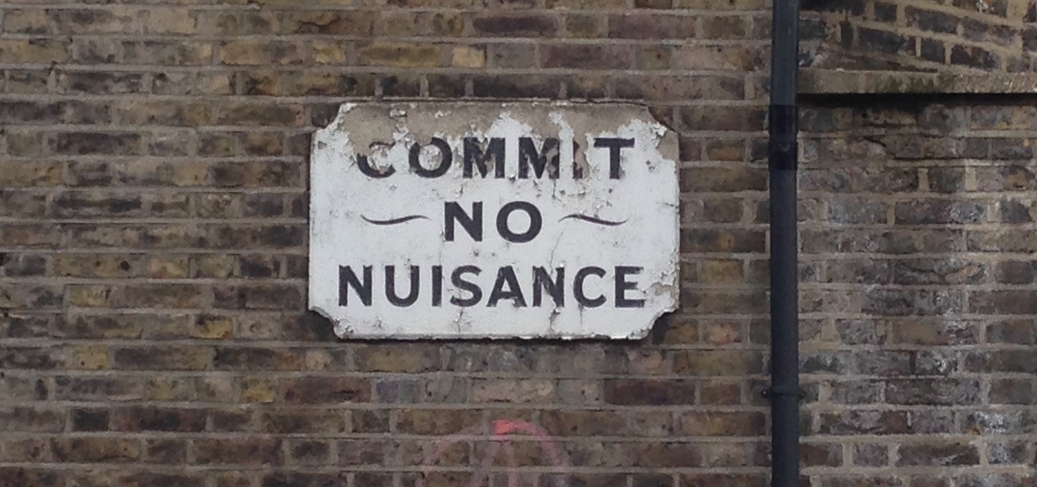 commit no nuisance sign on wall