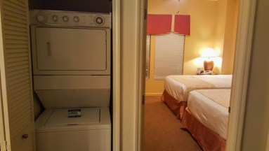 Two bedroom suite view of stacked washer/dryer unit