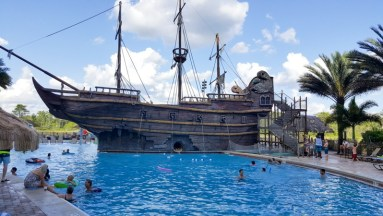 Pirates Plunge Pool featuring a waterslide in the ship