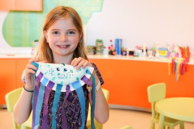 Kids make crafts at Just Kiddin'