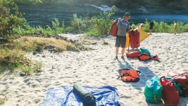 Setting up our tent site at our overnight beach camp spot on the Lower Salmon. © Stuffed Suitcase