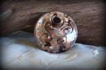 copper,black,silver colored glass disc